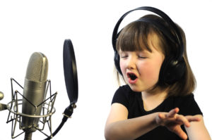 little girl engrossed in recording a song