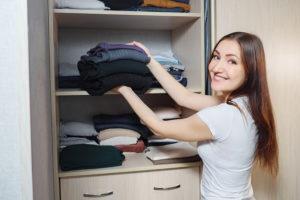 happy woman with organized closet